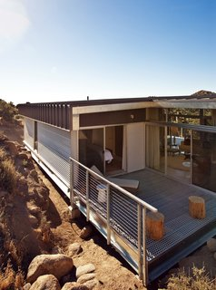 Offered at $674K, This Hybrid Prefab Is in Tune With the Californian Desert - Photo 6 of 7 - The back patio forms a corner between the master bedroom and main living area, creating a contemplative space for reading, relaxing, or simply enjoying the view.