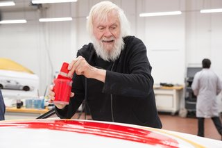 Baldessari paints an oversized red dot on the roof, staying true to his artistic trademark and boosting the car's visibility during the race.
