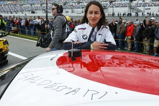 "McGough poses with the car, which bears Baldessari's signature. ""Having never been [to a race] before, I naively thought the sound of a car would be overwhelming, but it was exhilarating,"" she says of the Rolex 24. ""It just made my heart pump."""