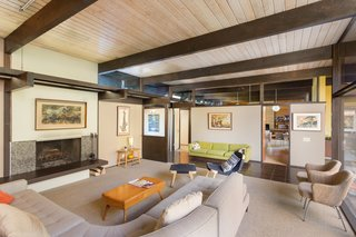 Snag This Midcentury Stunner in Southern California For $799K - Photo 6 of 10 - The fireplace in the living room provides a cozy setting for relaxing or entertaining. According to Matthew Berkley at Crosby Doe Associates, the design elements of the home recall the work of architects who had studied at USC—such as Fred McDowell.