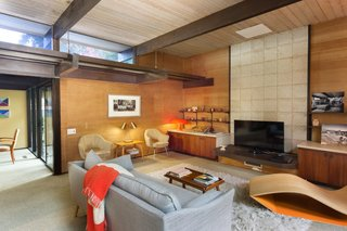 Snag This Midcentury Stunner in Southern California For $799K - Photo 4 of 10 - Clerestory windows allow more light to stream into the den.