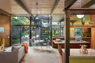 Snag This Midcentury Stunner in Southern California For $799K - Photo 3 of 10 - The kitchen and den, pictured above, as well as the living room and covered veranda open up to the backyard thanks to large glass walls. The rear of the house was rebuilt by architect Rufus Turner following a fire in the living room in 1964.