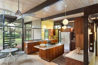 Snag This Midcentury Stunner in Southern California For $799K - Photo 5 of 10 - Carpeting, cork, and tile flooring run throughout the house, which is T-shaped in floor plan.