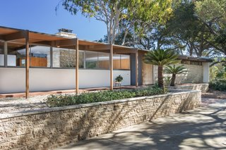 "Originally sited on 14 acres of avocado and lime trees, the 2,580-square-foot residence was designed by Richard Neutra for James Roberts, a successful businessman in the manufacturing business, and his wife in 1955. A horse and several sheep roamed the property. Listing agent Nate Cole shares this anecdote: ""Mrs. Roberts was an avid golfer, and she enjoyed driving golf balls out into the surrounding orchards. She would apparently send the kids out with buckets to retrieve them."""