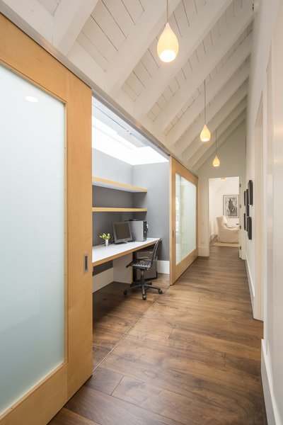 Skylights illuminate this tucked-away desk, which the homeowner can hide by sliding the doors closed.
