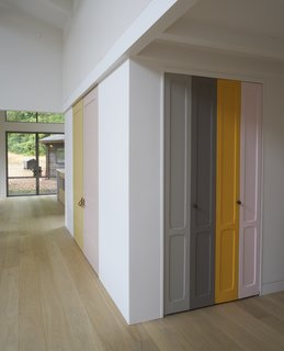 "A Northern Californian Renovation Brings Warmth to the Wilderness - Photo 1 of 6 - Playful panels of color on closet doors and the stair risers break up the white walls. The homeowner explains, ""I took as inspiration Imi Knoebel, whose work I had seen at the Dia Beacon, and who works with large shapes of color placed in relationship to one another."""