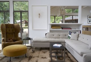 A Northern Californian Renovation Brings Warmth to the Wilderness - Photo 2 of 6 - The living room features furniture from BDDW. Much of art arrayed throughout the home was collected through auctions; Southern Exposure and The Luggage Gallery are two favorite sources.