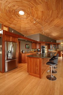 A Round Pennsylvania Prefab Offers 360-Degree Solutions in Sustainability - Photo 3 of 7 - Empowered to act as his own general contractor with Deltec Homes' support, Sanders cut wood from his own property for the ceiling, trim, and cabinetry—drying, forming, and finishing the material on site.