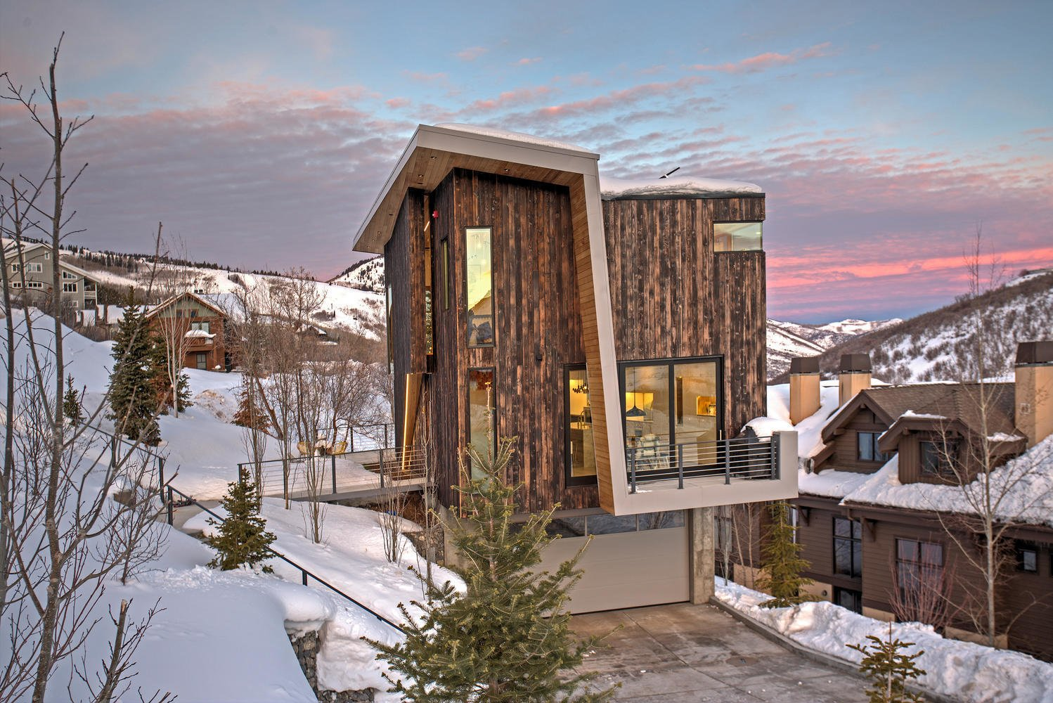 Exterior, Cabin Building Type, and Wood Siding Material  Photo 1 of 10 in A Plunging Roof Carves Out Space in This Park City Home Offered at $2.4M