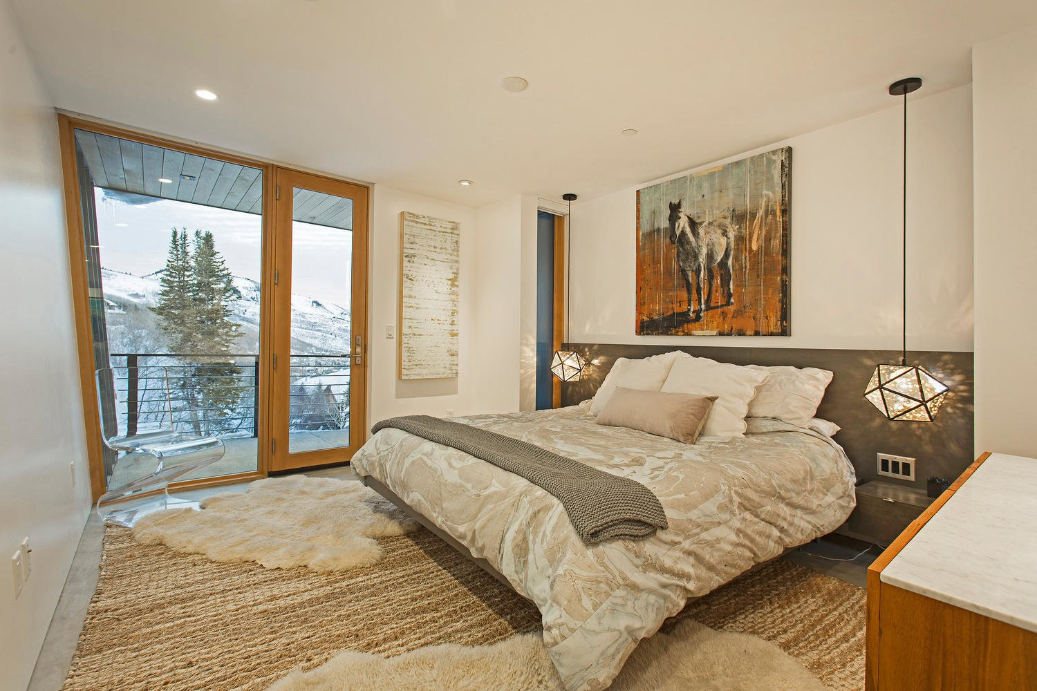The master bedroom has access to a private terrace with alpine vistas.  Photo 7 of 10 in A Plunging Roof Carves Out Space in This Park City Home Offered at $2.4M