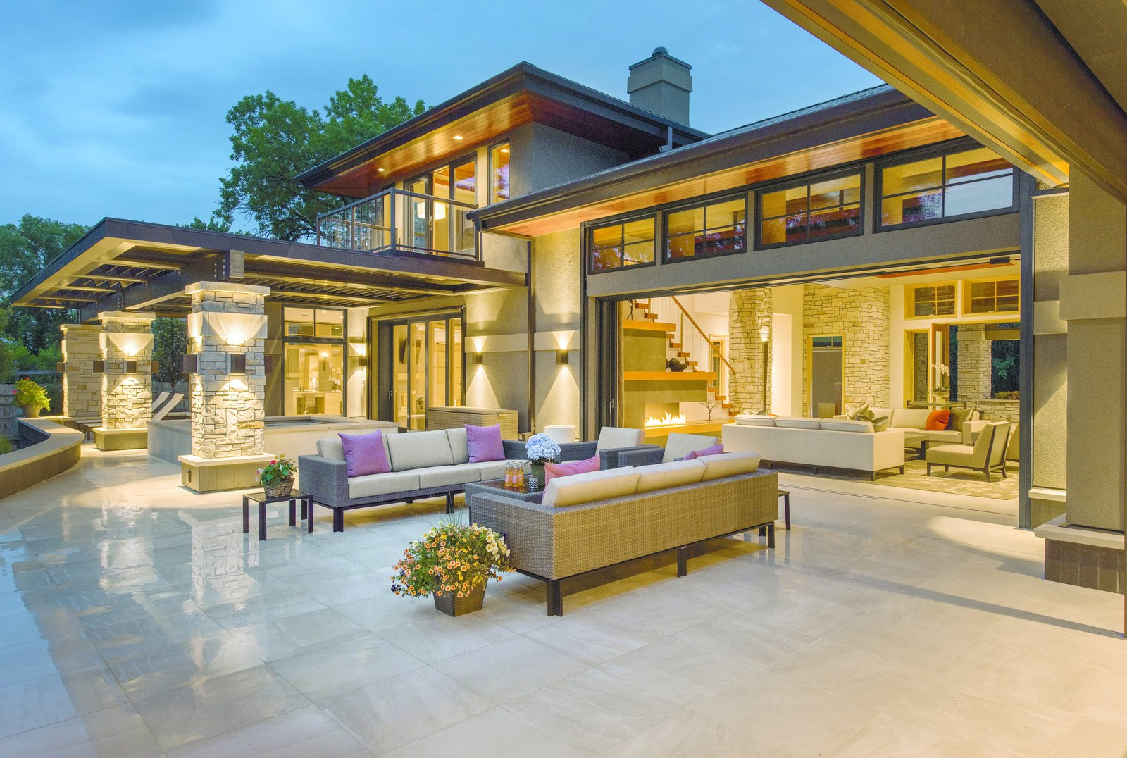 Nestled on the banks of the St. Croix River in Minnesota, this contemporary home merges the living room with an expansive deck with a disappearing Ultimate Multi-Slide Door by Marvin.  Photo 1 of 6 in How to Set the Stage For Outdoor Living With Scenic Doors
