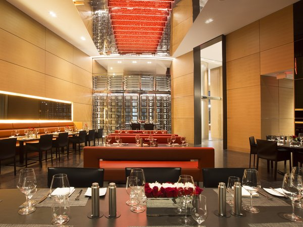 A restaurant caters to residents with indoor and outdoor seating, a lounge bar overlooking the Atlantic, and private wine lockers.  Photo 5 of 11 in Porsche Design's Lavish Residential Tower in Miami Lifts Residents and Cars Sky High