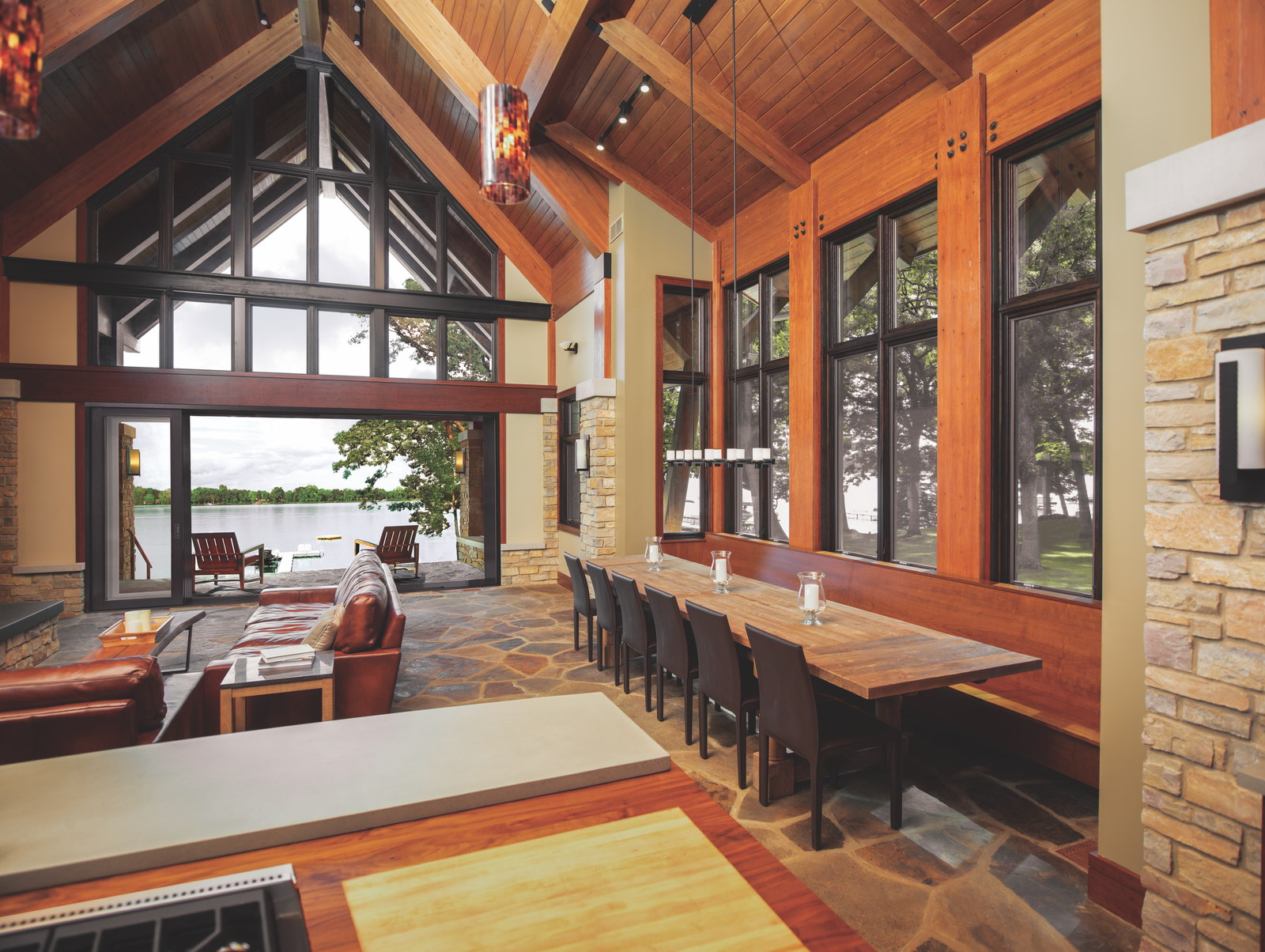 This home merges an open living space with a serene porch overlooking the water with a Marvin Ultimate Multi-Slide Door.  Photo 2 of 6 in How to Set the Stage For Outdoor Living With Scenic Doors
