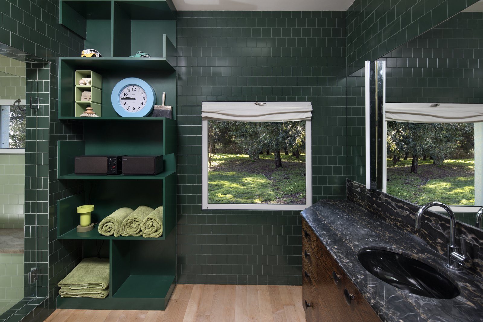 The master bathroom forges a connection to the outdoors through dark, forest green tile.  Photo 8 of 12 in IDEO Founder David Kelley Asks $13.5M For His Ettore Sottsass-Designed Masterpiece