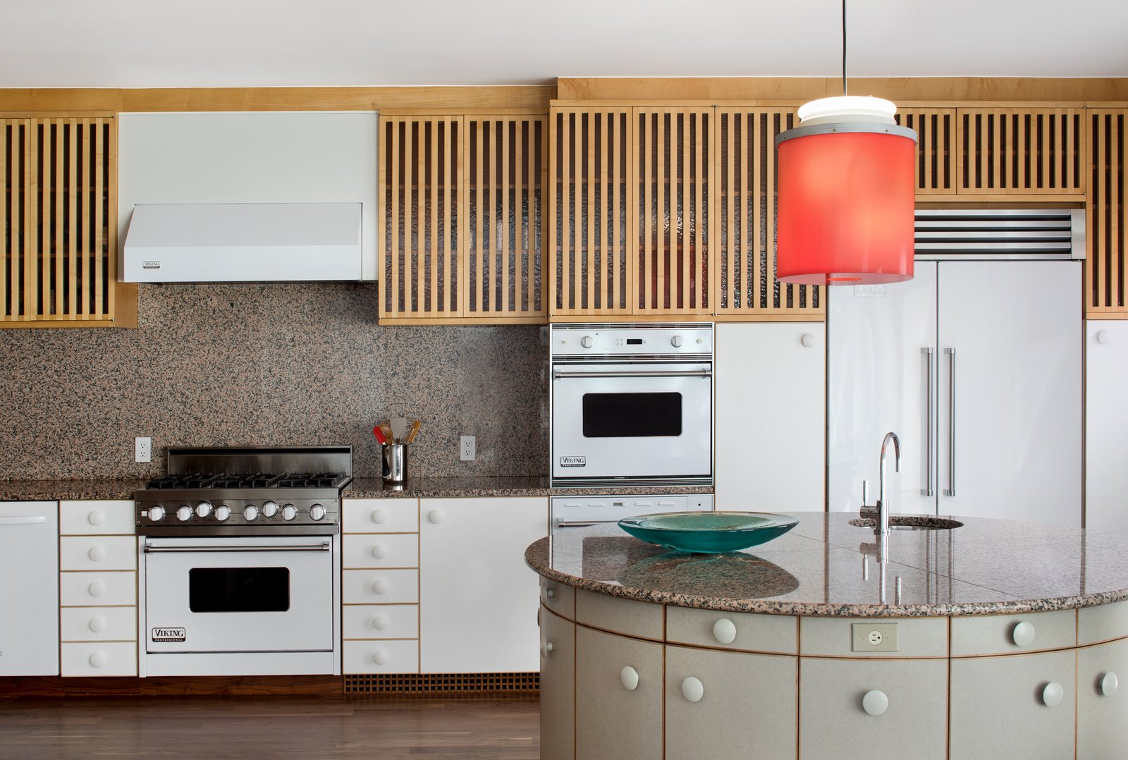 Oversized knobs add a whimsical touch to the kitchen, where a pendant designed by Johanna Grawunder—who worked with Sottsass in Milan—hangs over the circular island. White Viking appliances are integrated with the cabinetry.  Photo 3 of 12 in IDEO Founder David Kelley Asks $13.5M For His Ettore Sottsass-Designed Masterpiece