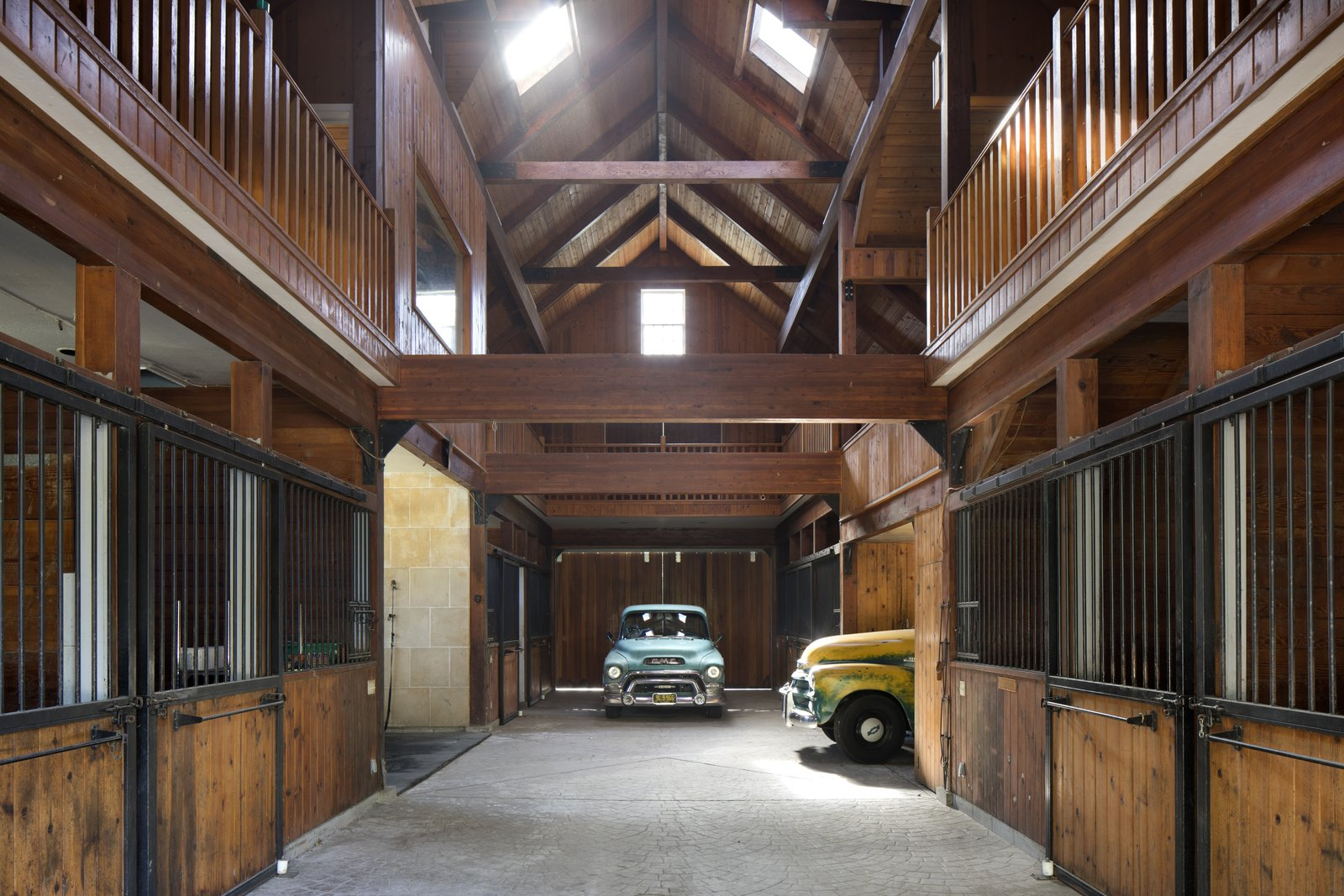 After Kelley's wife moved the horses to another property, he used one of the outbuildings as a design studio, and repurposed the barn for his classic car collection.  Photo 12 of 12 in IDEO Founder David Kelley Asks $13.5M For His Ettore Sottsass-Designed Masterpiece