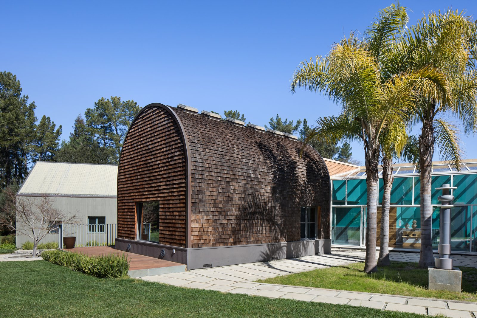 The disjunction between each pavilion is most visible from a rear view, which reveals the variety of materials used, from glass to wood to brick.  Photo 9 of 12 in IDEO Founder David Kelley Asks $13.5M For His Ettore Sottsass-Designed Masterpiece