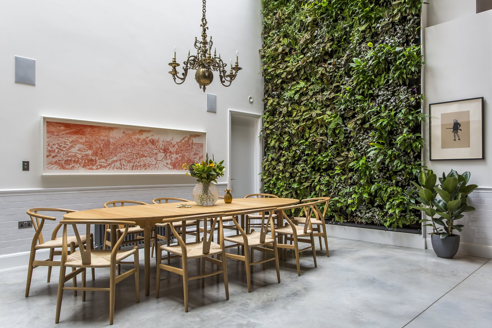 Dining Room, Pendant Lighting, Table, Chair, and Concrete Floor The living wall designed by Scotscape provides a refreshing backdrop to the dining area.  Photo 7 of 8 in Stay in a Converted Victorian Cooperage in London