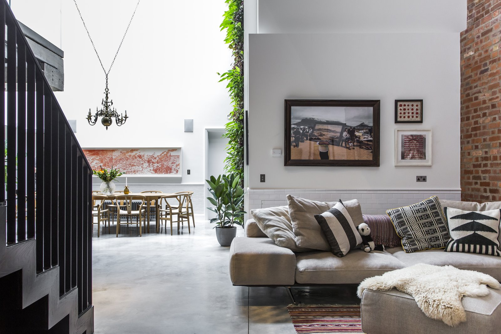 Living Room, Sofa, Table, Concrete Floor, Rug Floor, Chair, Pendant Lighting, and Ottomans Interior designer Andrea Larsson Sanchez complements the polished concrete floor, original Crittall windows, and exposed brick with contemporary furnishings and graphic textiles.  Photo 3 of 8 in Stay in a Converted Victorian Cooperage in London