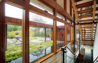 A two-story glass curtain wall allows for natural light and views to permeate the space and the open stairs.
