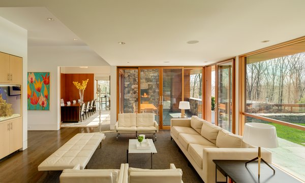 The family room enjoys broad views of the landscaped property and leads to an outdoor terrace and fireplace.