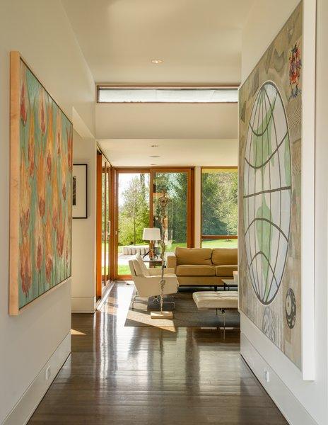 Mahogany windows and doors, black walnut floors, and beech veneer millwork create warmth in the bright interior.