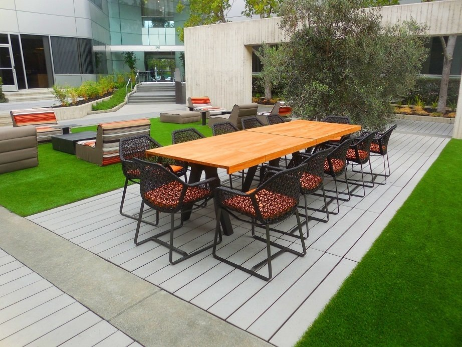 A commercial space in San Mateo, California, boasts Large Scale CalArc Pavers that echo the structural lines of the aluminum- and glass-clad building.  Photo 5 of 8 in Drawing the Line: Concrete Pavers That Advance Architectural Design