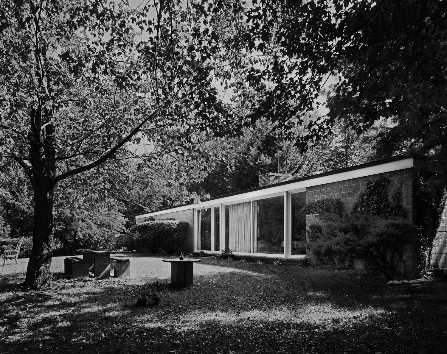A 1976 photo by Robert Damora shows the Booth House in its forested setting. Robert, who developed techniques to capture a sense of space and volume, was once hailed by Walter Gropius as  Photo 2 of 10 in With $1 Million, You Can Save Philip Johnson's First Commissioned House