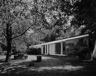 "A 1976 photo by Robert Damora shows the Booth House in its forested setting. Robert, who developed techniques to capture a sense of space and volume, was once hailed by Walter Gropius as ""the best photographer of architecture in this country."""