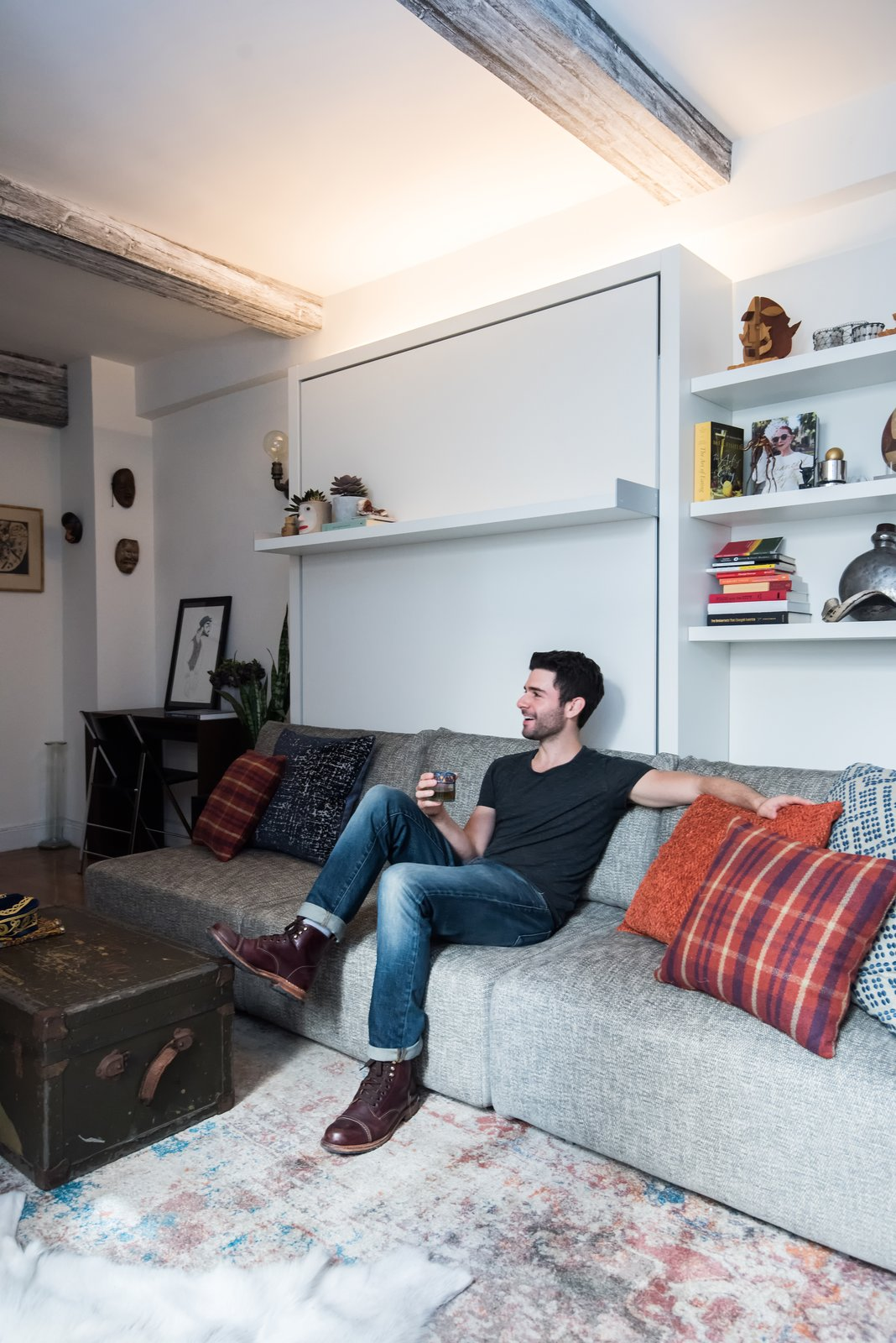 Strip lights above the Swing unit add height to the studio. Concrete wallpaper by Resource Furniture adorns the ceiling beams.  Photo 3 of 6 in Big on Broadway, Small on Space: Inside the Studio of Actor Adam Kantor