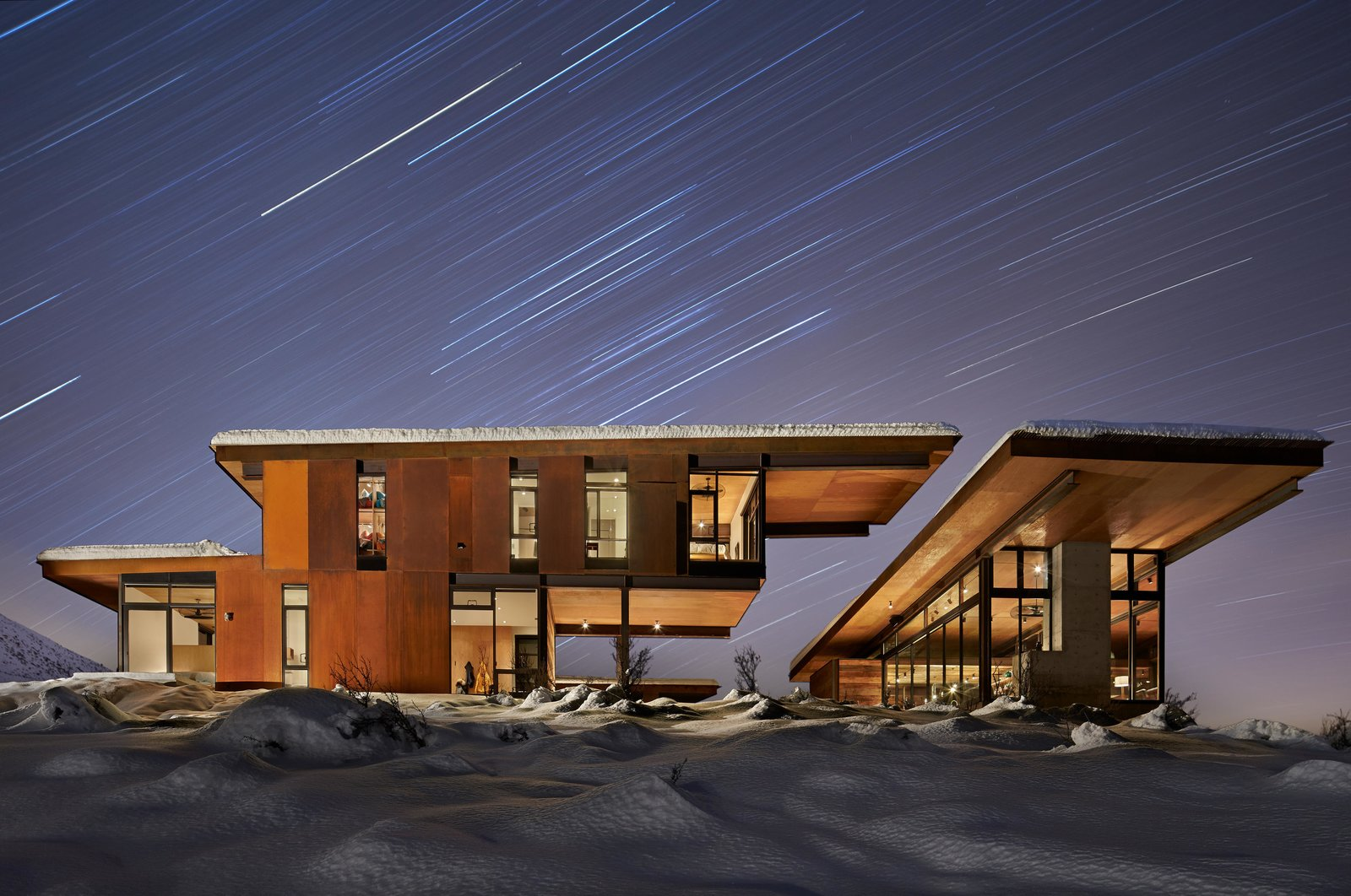 Exterior, Cabin Building Type, House Building Type, Metal Siding Material, Metal Roof Material, and Shed RoofLine  Best Photos from A Steel-and-Glass Compound Is One Family's Launchpad For Adventure