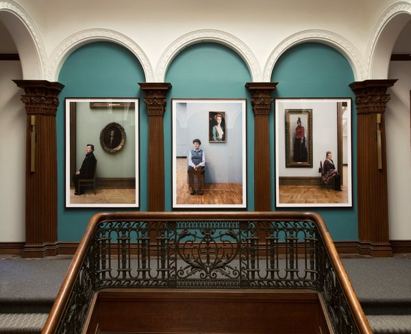 """""""Guardians"""" by Evie Simon and Stephanie Breitbard of Simon Breitbard Fine Arts elegantly graces the landing with Russian portraiture."""