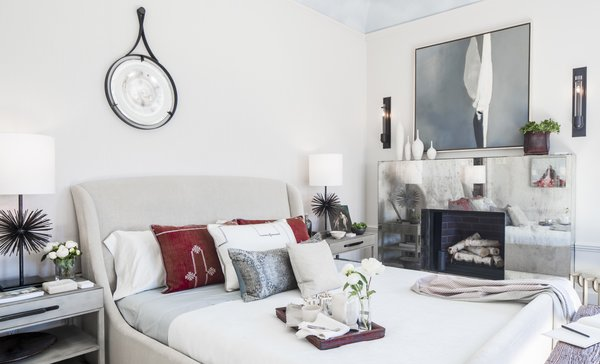 Beth Martin's master bedroom takes advantage of ample natural light with a mirrored fireplace mantle.