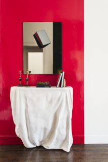 The white plaster Draper Console and modern Cube Mirror embody an unconventional spirit.