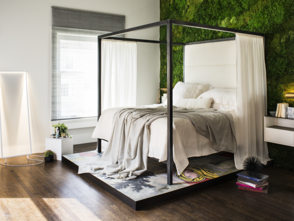 """Referencing the progress of modern fashion, art, and culture, Jaimie Belew's bedroom suite marries softer elements, like the preserved living wall and textiles, with graphic accents for a """"Modern Avant Garde setting."""""""