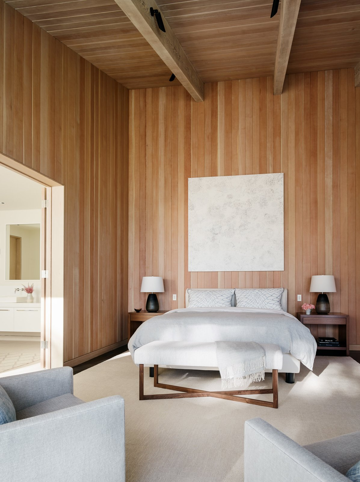 Bedroom, Bed, Chair, Rug Floor, Dark Hardwood Floor, and Night Stands  Photos from This Renovated Sea Ranch Retreat Is an Absolute Must-See