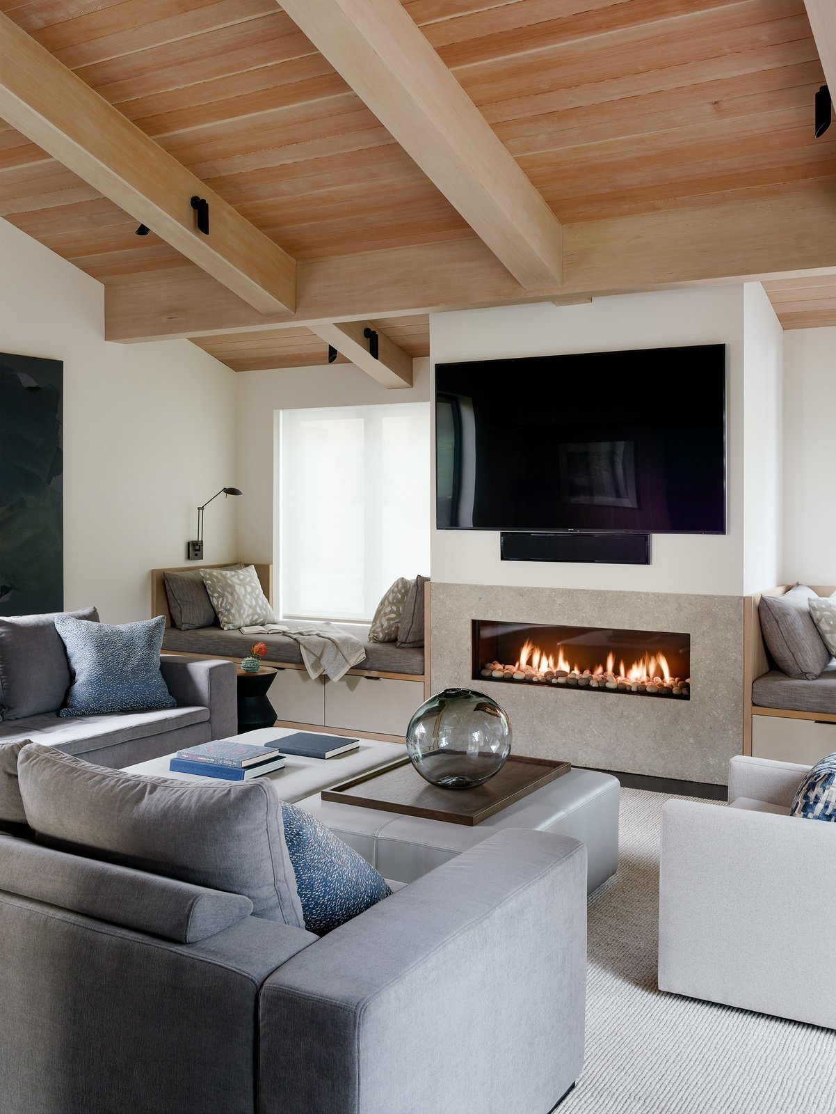 Living Room, Chair, Bench, Rug Floor, Sofa, Gas Burning Fireplace, and Standard Layout Fireplace  Photo 6 of 15 in This Renovated Sea Ranch Retreat Is an Absolute Must-See