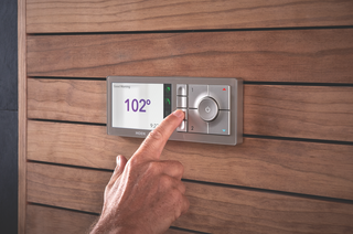 Large, intuitive-to-use buttons save your presets on the U by Moen controller, which is designed to blend into a variety of bathroom styles.