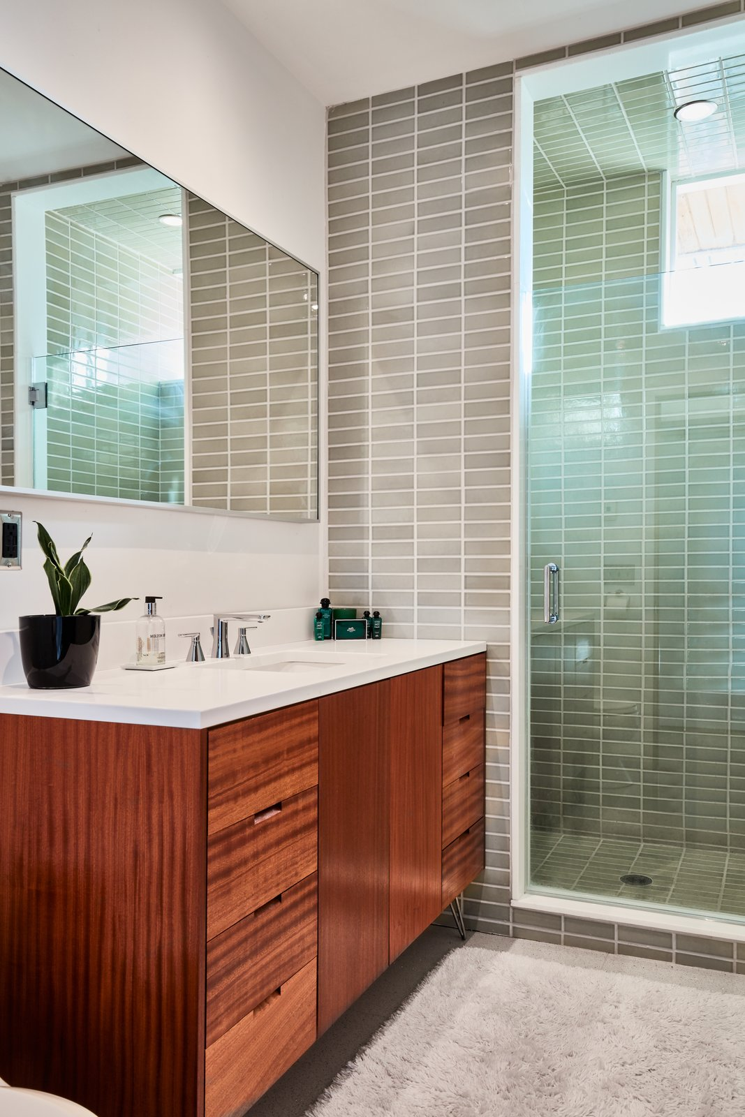 Bath Room, Undermount Sink, and Enclosed Shower  Photo 12 of 13 in The Stunningly Restored Hassrick Residence by Richard Neutra Hits the Market at $2.2M