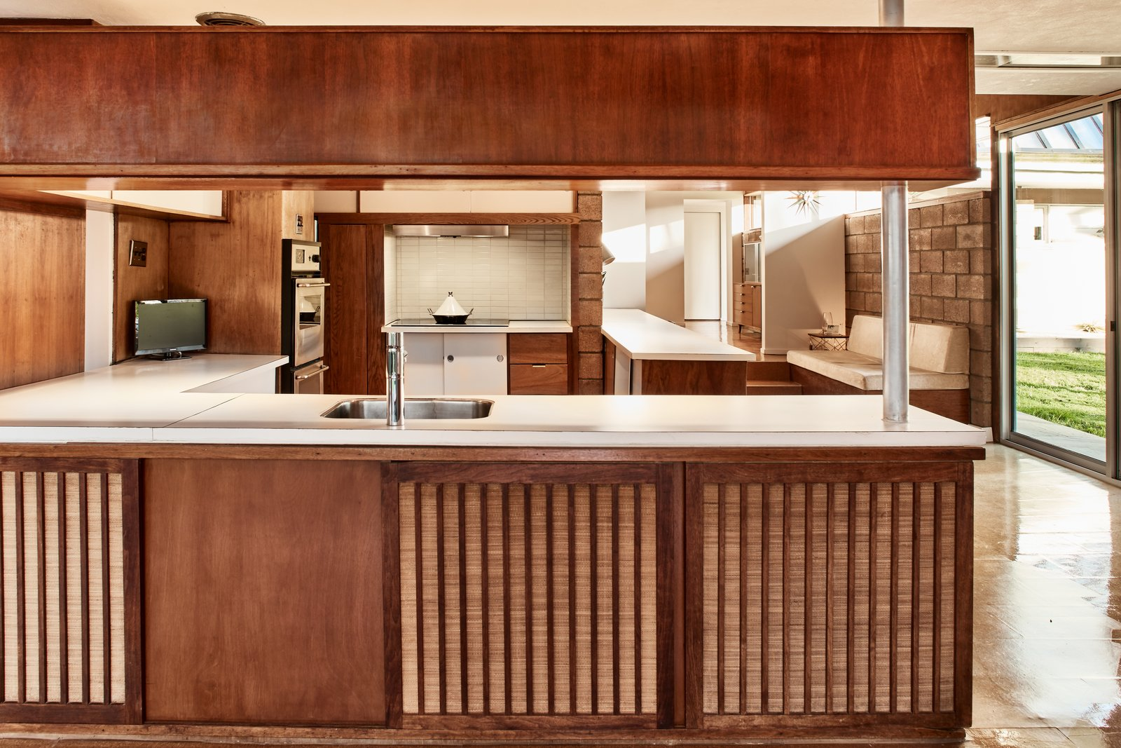 Kitchen and Wood Cabinet  Photo 6 of 13 in The Stunningly Restored Hassrick Residence by Richard Neutra Hits the Market at $2.2M