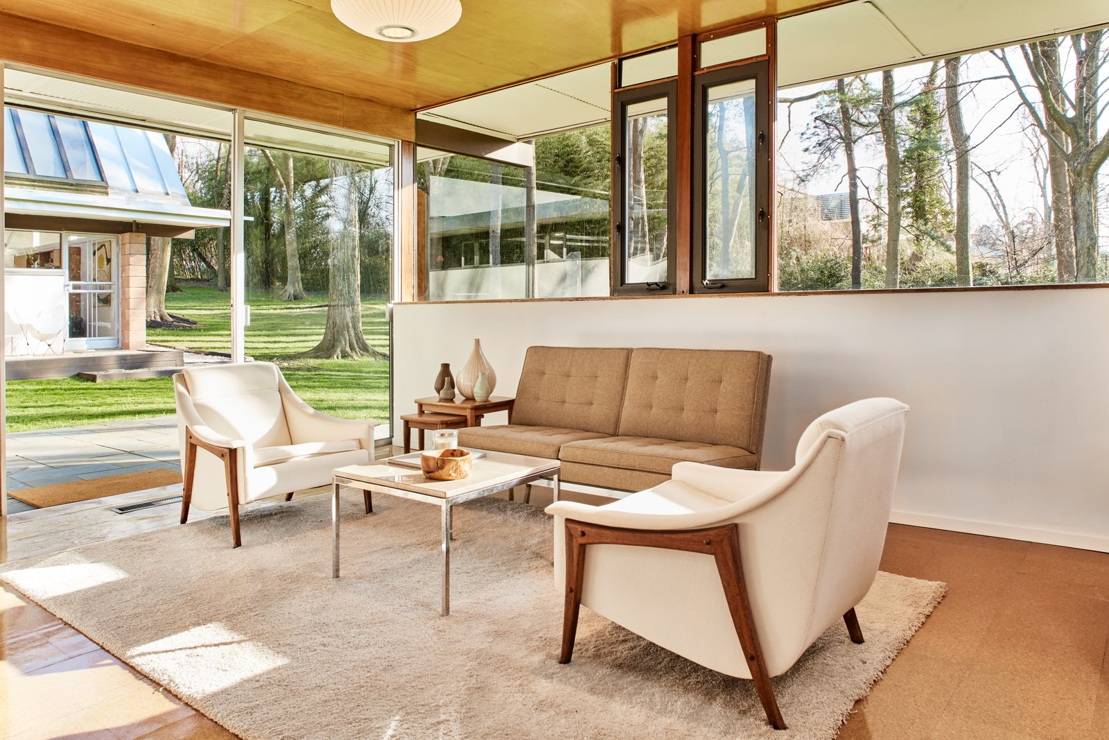 Living Room, Chair, Sofa, and Pendant Lighting  Photo 9 of 13 in The Stunningly Restored Hassrick Residence by Richard Neutra Hits the Market at $2.2M