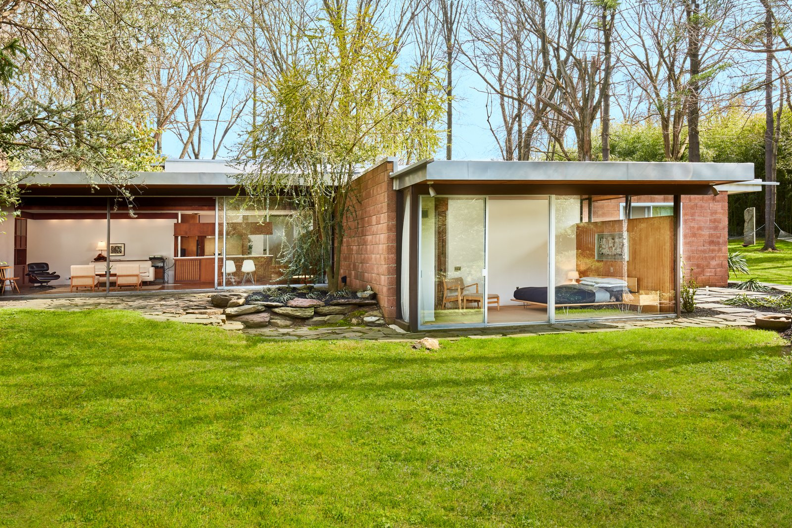 Outdoor, Grass, and Back Yard  Photo 1 of 13 in The Stunningly Restored Hassrick Residence by Richard Neutra Hits the Market at $2.2M
