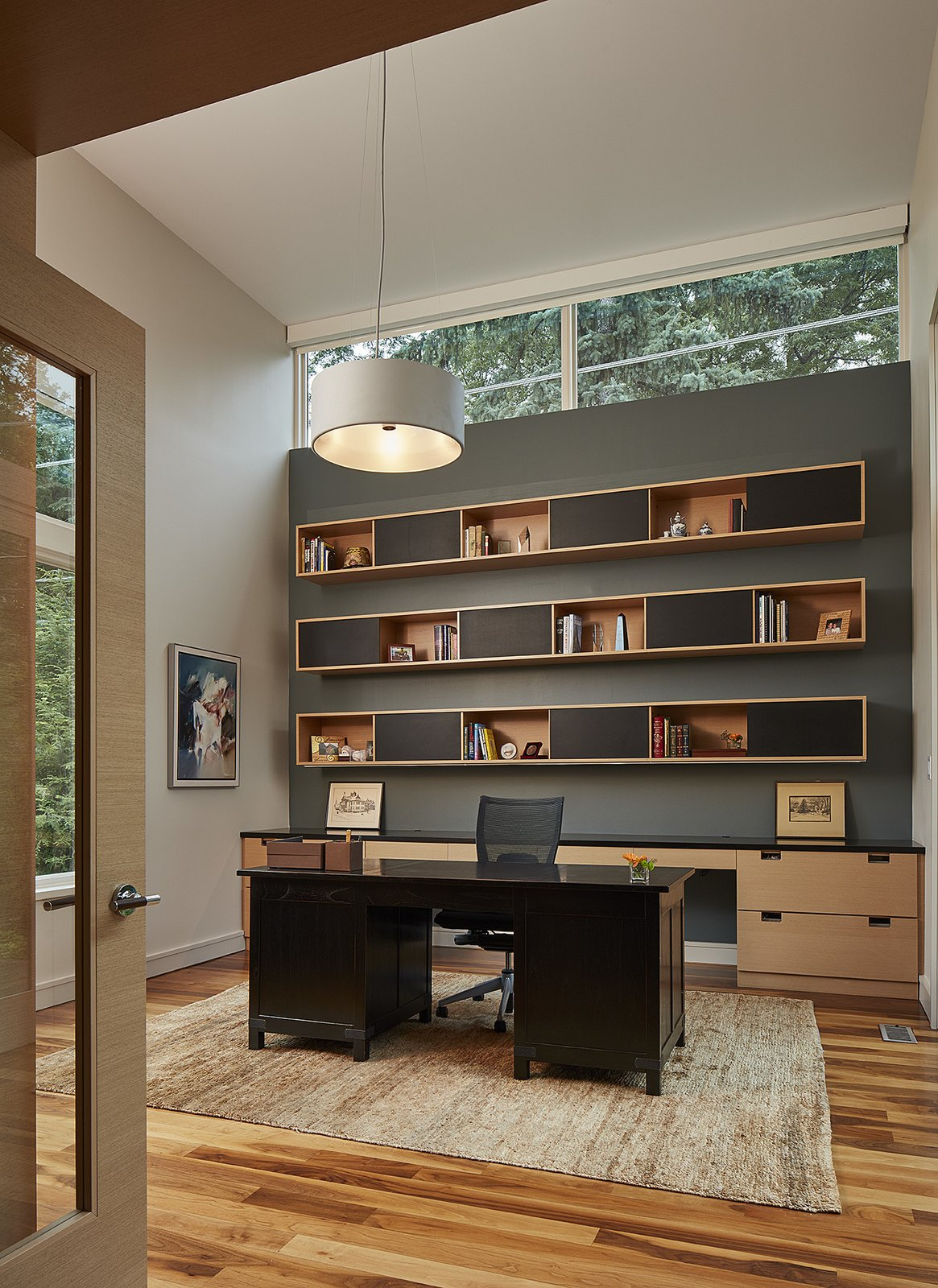 Office, Study Room Type, Chair, Medium Hardwood Floor, and Desk Jim's office is removed from family areas.  Photo 7 of 8 in An Accessible Home Promotes a Lifetime of Well-Being For the Whole Family