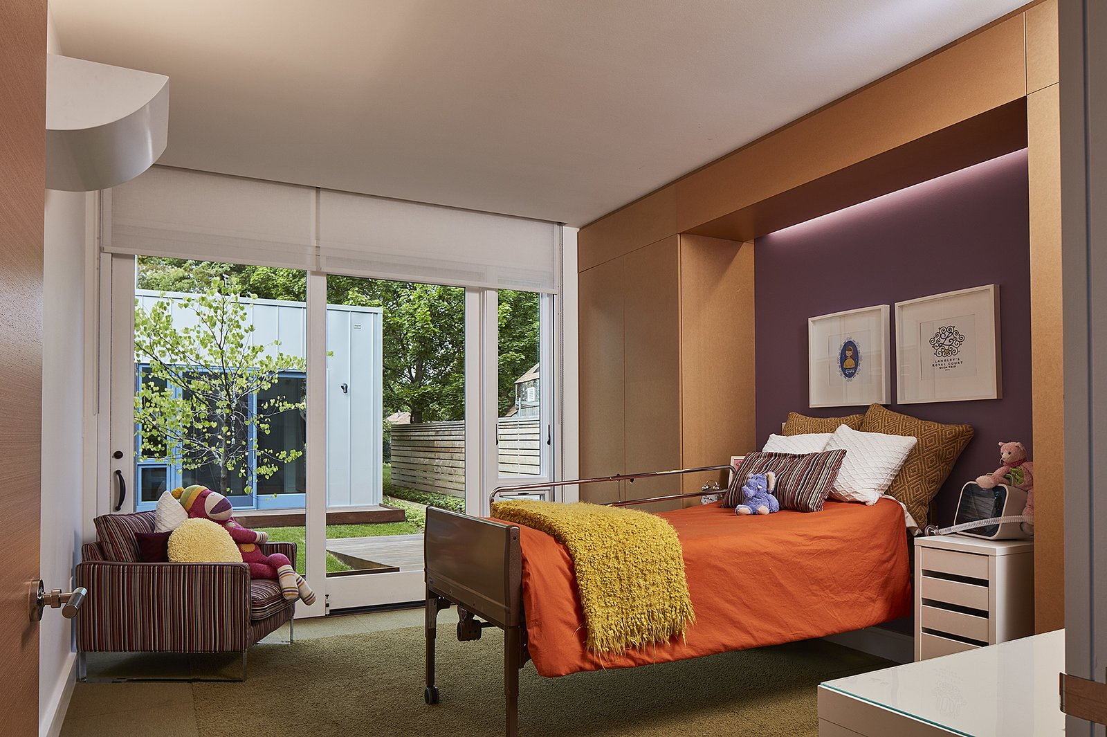 The children's bedrooms have access to their own shared courtyard. Tagged: Bedroom, Bed, Night Stands, and Chair.  Photo 8 of 8 in An Accessible Home Promotes a Lifetime of Well-Being For the Whole Family