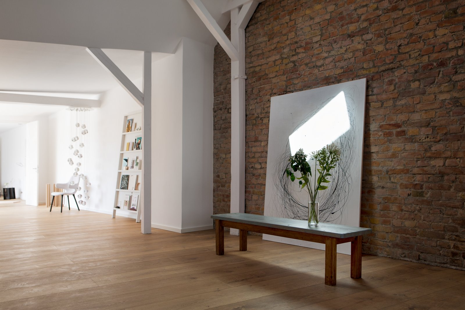 Medium Hardwood Floor, Floor Lighting, Sofa, End Tables, and Living Room  Photo 3 of 13 in This Modern Loft For Sale Will Have You Dreaming of Berlin