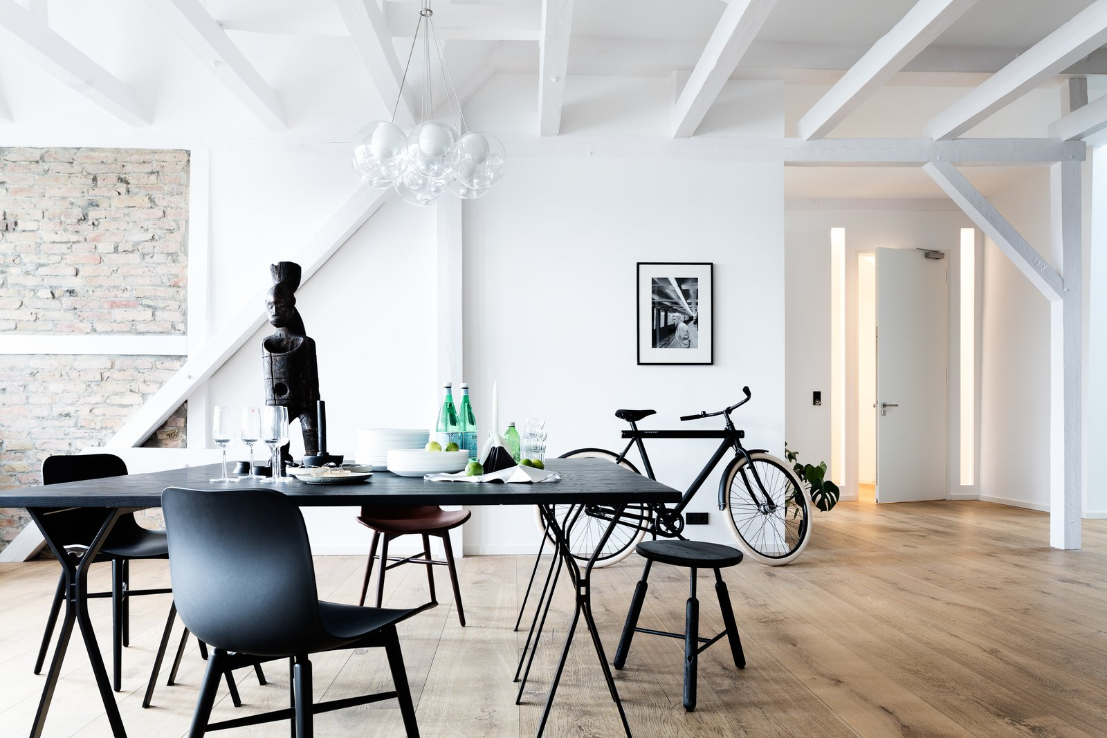 Bed, Medium Hardwood Floor, and Dining Room  Photo 5 of 13 in This Modern Loft For Sale Will Have You Dreaming of Berlin