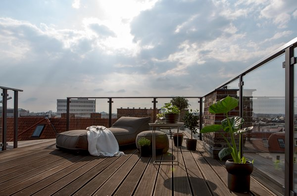 Bed, Outdoor, Table, Chair, Open Shower, and Vessel Sink  Photo 12 of 13 in This Modern Loft For Sale Will Have You Dreaming of Berlin