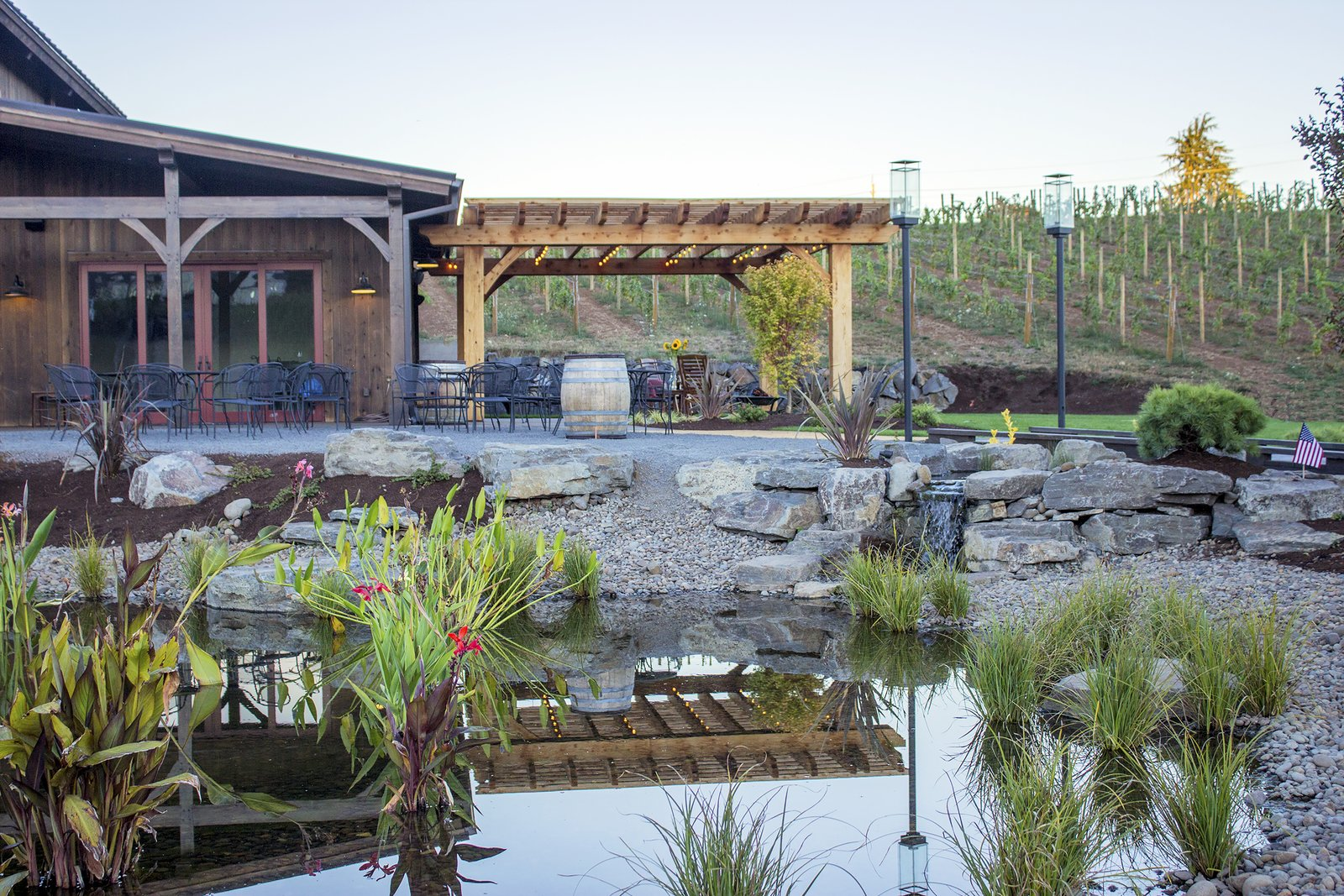 Landscaped ponds create a charming outdoor setting.  Photo 4 of 7 in Sustainable Redwood Stars in an Oregon Architectural Showcase