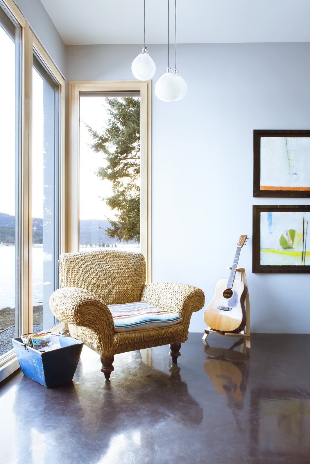 Living Room, Chair, and Pendant Lighting A family room is another flexible living space awash in natural light.  Photo 6 of 11 in A Rock & Roll Hall of Famer's Picturesque Montana Retreat Is Going Up For Auction
