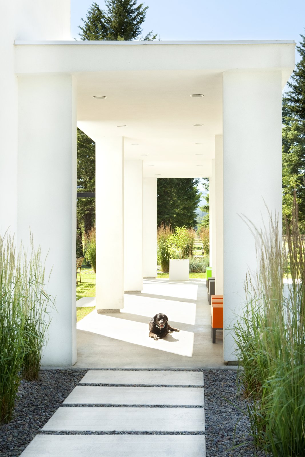 Outdoor, Walkways, Front Yard, Pavers Patio, Porch, Deck, and Concrete Patio, Porch, Deck An open-air entry pavilion contributes to a sense of arrival at the home.  Photo 2 of 11 in A Rock & Roll Hall of Famer's Picturesque Montana Retreat Is Going Up For Auction